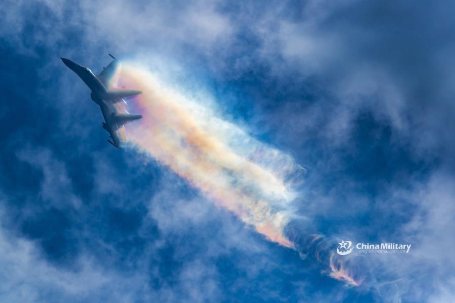 J-11B fighter jets perform stiff pitch in flight training