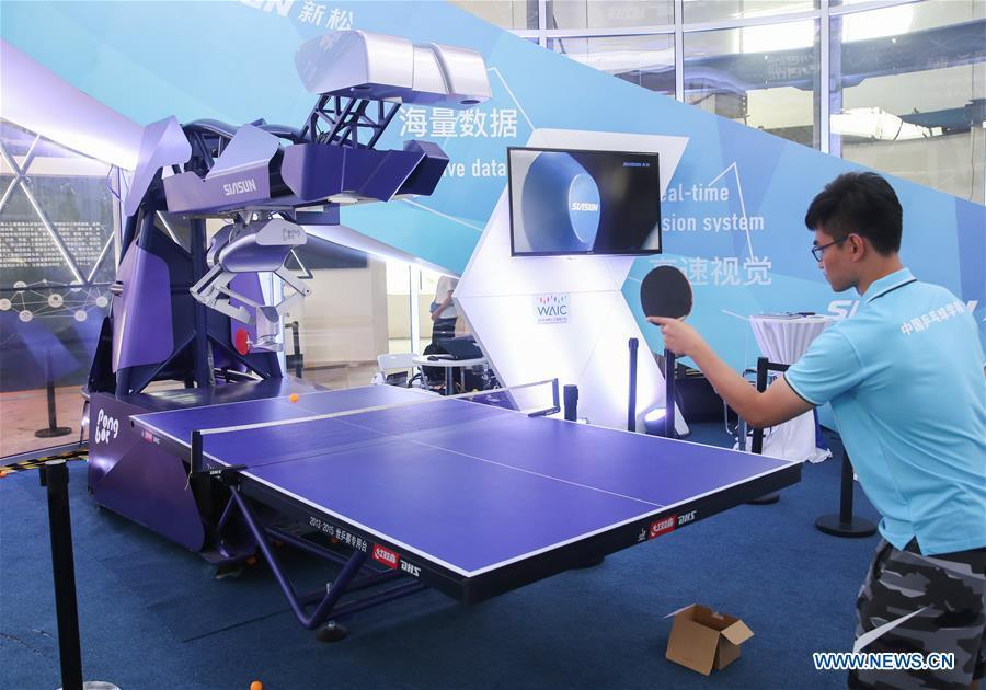 A staff member plays table tennis with a robot during the World Artificial Intelligence Conference (WAIC) 2018 in Shanghai, east China, Sept. 17, 2018. The three-day conference has attracted experts, scholars and entrepreneurs from nearly 40 countries and regions. More than 200 leading companies in AI participated in the conference and the exhibition. (Xinhua/Ding Ting)