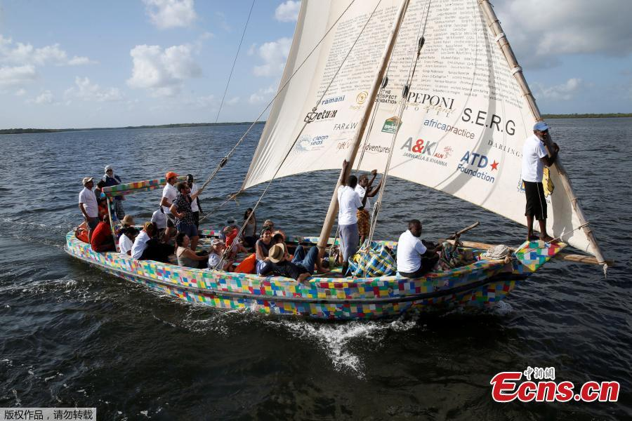 People take part in the first voyage sail of Flipflopi, the first dhow boat made entirely of recycled plastic, after the launch ceremony on the island of Lamu, Kenya, Sept. 15, 2018. Kenyan islanders have built a boat made entirely of recycled plastic collected during clean-ups of the ocean to highlight the growing menace of plastic waste that ends up in the sea.(Photo/Agencies)