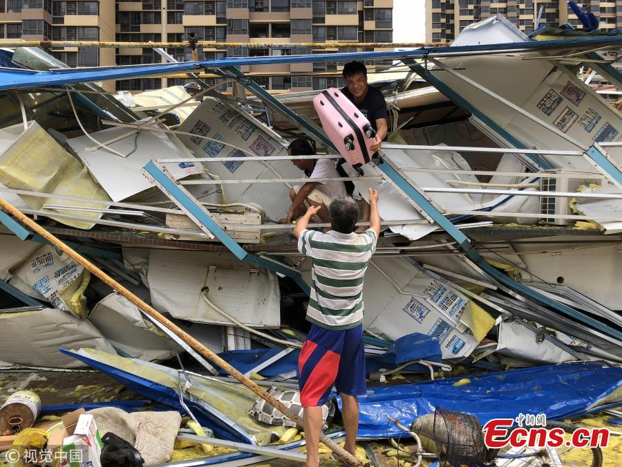 People search for their belongings in a dormitory building damaged by Super Typhoon Mangkhut in Zhuhai City, South China's Guangdong Province, Sept. 17, 2018. (Photo/VCG)