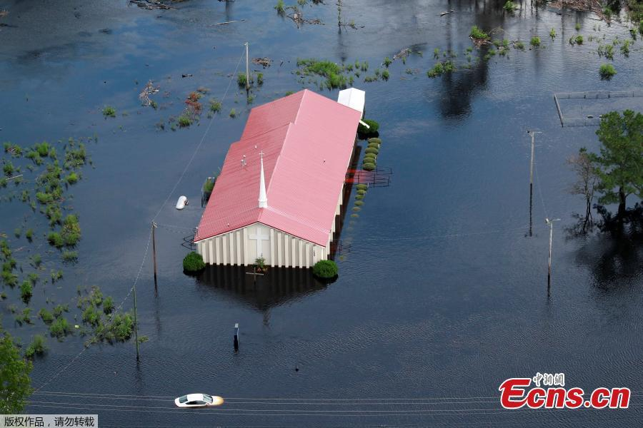 Houses sit in floodwater caused by Hurricane Florence, in this aerial picture, on the outskirts of Lumberton, North Carolina, U.S. Sept. 16, 2018. Deadly storm Florence drenched North Carolina with more downpours on Sunday, cutting off the coastal city of Wilmington, damaging tens of thousands of homes and threatening worse flooding as rivers fill to the bursting point. (Photo/Agencies)