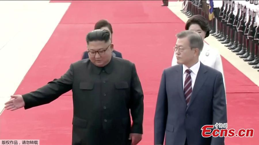 In this image made from video, South Korean President Moon Jae-in, right, is welcomed by the Democratic People\'s Republic of Korea leader Kim Jong Un for a photo on the podium upon arrival in Pyongyang, Sept. 18, 2018. Moon landed in Pyongyang for his third summit this year with Kim. (Photo/Agencies)