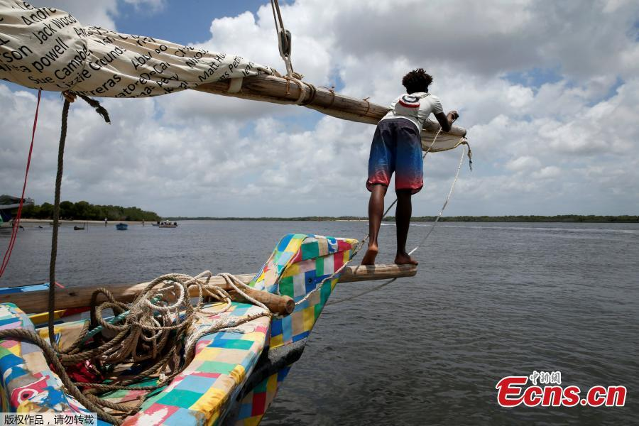 A man stands on the front of Flipflopi, the first dhow boat made entirely of recycled plastic before its launch ceremony on the island of Lamu, Kenya, Sept. 15, 2018. Kenyan islanders have built a boat made entirely of recycled plastic collected during clean-ups of the ocean to highlight the growing menace of plastic waste that ends up in the sea.(Photo/Agencies)