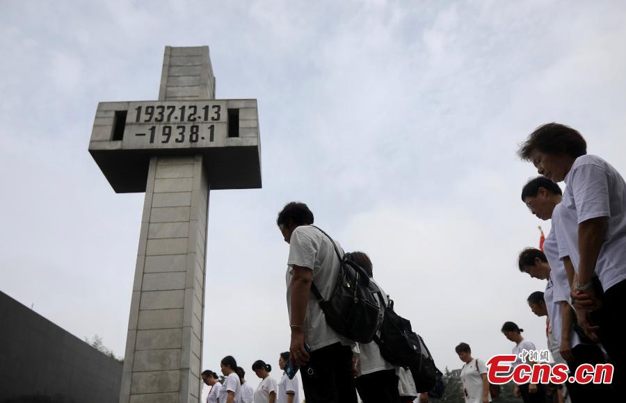 Visitors pause to mourn the deceased in silence at the Memorial Hall of the Victims in Nanjing Massacre by Japanese Invaders in Nanjing City, Jiangsu Province, Sept. 18, 2018. On September 18, 1931, the Japanese Kwantung Army stationed in northeast China destroyed a section of the railway near Liutiaohu and then falsely accused the Chinese military of causing the explosion. Using this as a pretext, the Japanese then bombarded Shenyang and began invasion of northeast China. (Photo: China News Service/Yang Bo)