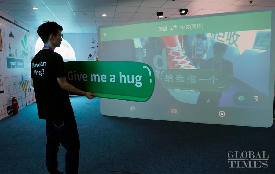 A man interacts with the Google AI translator. (Photo: Yang Hui/GT)