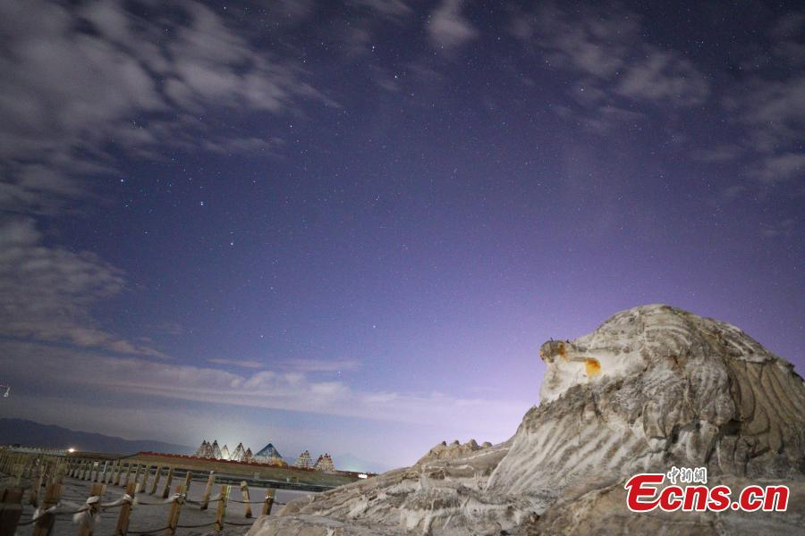 "A sculpture near the Chaka Lake under a starry sky. ""Chaka"" means ""salt lake"" in Tibetan. Chaka Salt Lake is located near Chaka township in Wulan county in the east of the Qaidam Basin of Northwest China's Qinghai Province. By day, the azure sky and floating clouds as well as mountains in the distance are reflected in the lake, creating a mirror of the sky in China. A starry night-themed photography festival, organized by the China News Service and the China Media Culture Promotion Association as well as other organizations, took place in the Chaka Lake scenic area. The lake area has been announced by a committee as the best venue in the country to take photos of the night sky. (Photo: China News Service/Wang Junfeng)"