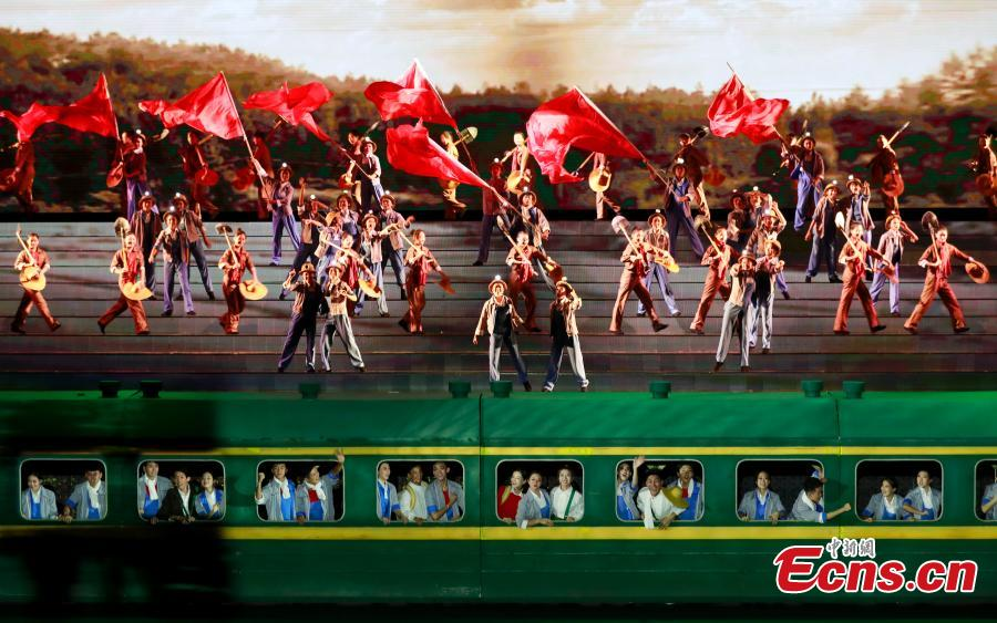 Performers take part in an evening gala to celebrate the 60th anniversary of the founding of the Ningxia Hui autonomous region in Yinchuan on Sept 19, 2018.(Photo: China News Service/ Du Yang)