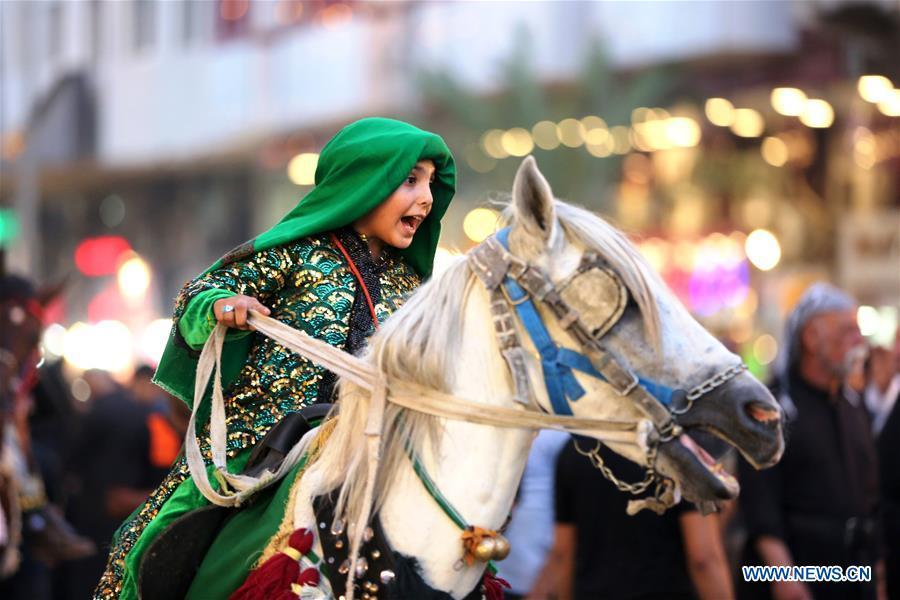 A girl participates in the celebration of upcoming Ashura in Baghdad, Iraq, Sept. 19, 2018. Ashura, the 10th day of the Islamic month of Muharram, marks the martyrdom of Imam Hussein, the grandson of Prophet Mohammad, in the battle of Kerbala in Iraq in the year 680. (Xinhua/Khalil Dawood)