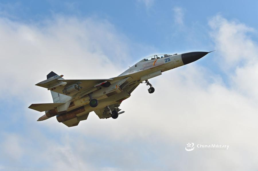 A J-11B fighter jet attached to an aviation brigade of the South China Sea Fleet under the PLA Navy takes off for a sortie during a live-fire flight training exercise near the South China Sea on September 19, 2018.  (Photo/eng.chinamil.com.cn)