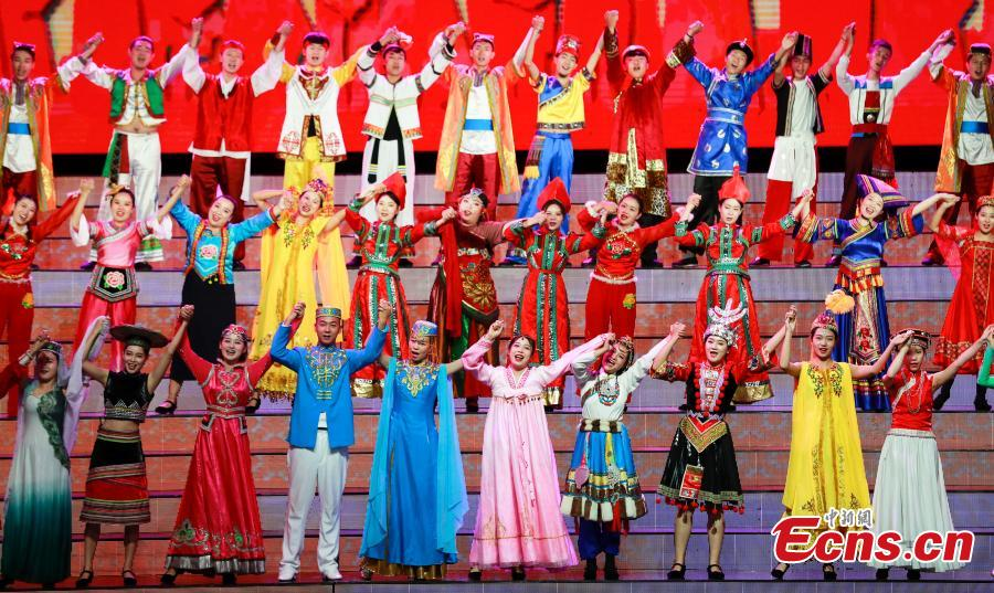 Performers sing at an evening gala to celebrate the 60th anniversary of the founding of the Ningxia Hui autonomous region in Yinchuan on Sept 19, 2018. (Photo: China News Service/ Du Yang)