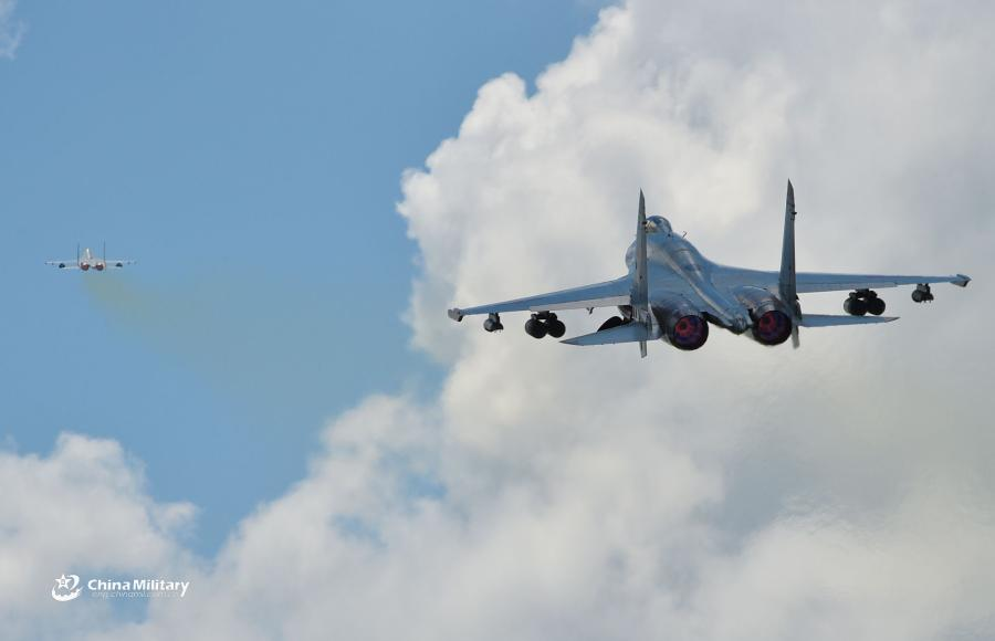 Two J-11B fighter jets attached to an aviation brigade of the South China Sea Fleet under the PLA Navy take off for a sortie during a live-fire flight training exercise near the South China Sea on September 19, 2018. (Photo/eng.chinamil.com.cn)