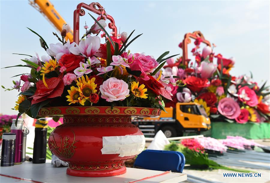 Artificial flowers are placed at the Tiananmen Square in Beijing, capital of China, Sept. 20, 2018. A 17-meter-tall installation in the shape of a flower basket with a diameter of 50 meters at the bottom is placed at the center of the Tiananmen Square as a decoration for China\'s upcoming National Day holiday. (Xinhua/Luo Xiaoguang)