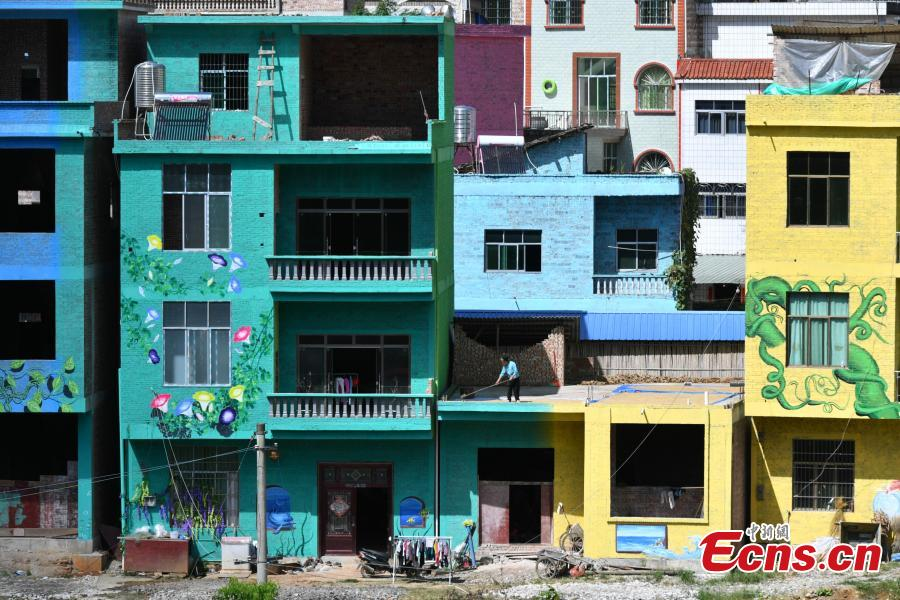 A view of the colorful buildings at Heye Village in Guangnan County, Southwest China's Yunnan Province, Sept. 20, 2018. A group of artists began painting buildings and trees in different colors one month ago in order to help attract tourists to the village. (Photo: China News Service/Ren Dong)