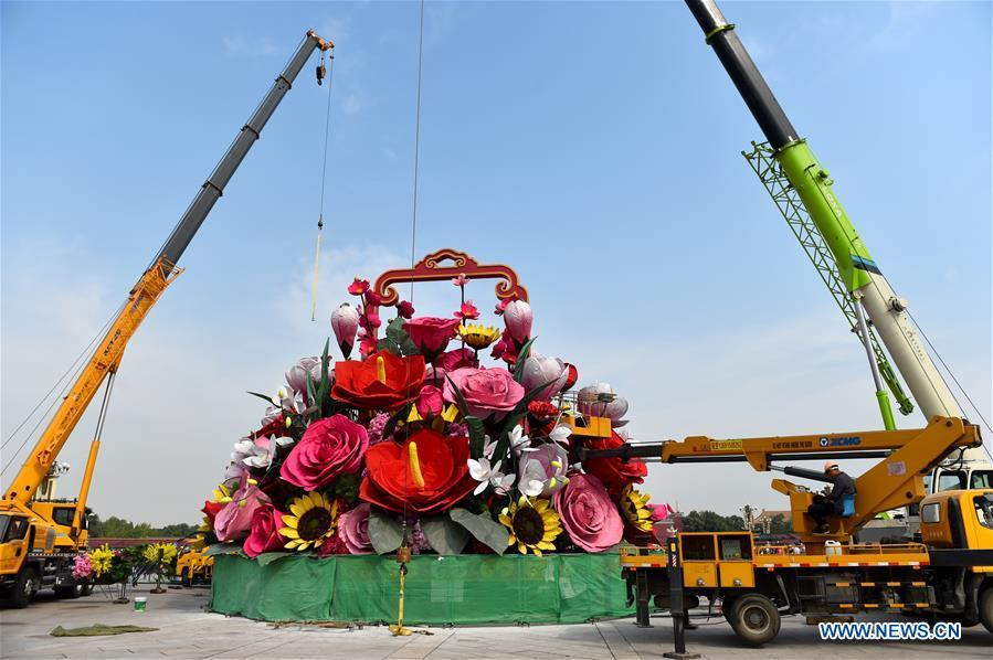 An artificial flower basket is placed at the Tiananmen Square in Beijing, capital of China, Sept. 20, 2018. A 17-meter-tall installation in the shape of a flower basket with a diameter of 50 meters at the bottom is placed at the center of the Tiananmen Square as a decoration for China\'s upcoming National Day holiday. (Xinhua/Luo Xiaoguang)
