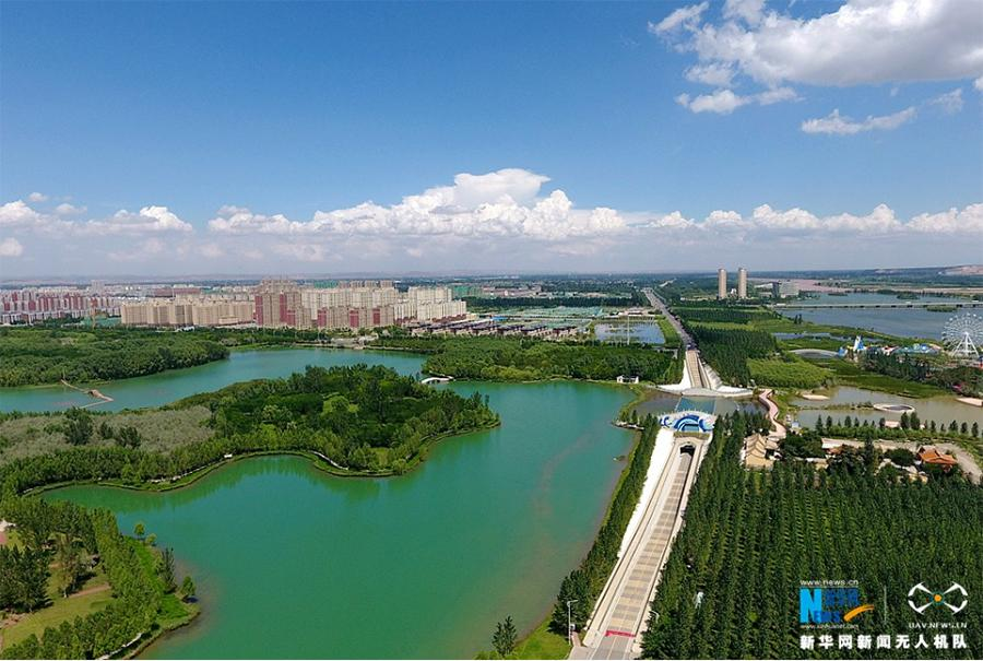 A photo taken Aug 27 shows Xiangshan Lake national wetland park in Zhongwei city, Ningxia Hui autonomous region. (Photo/Xinhua)