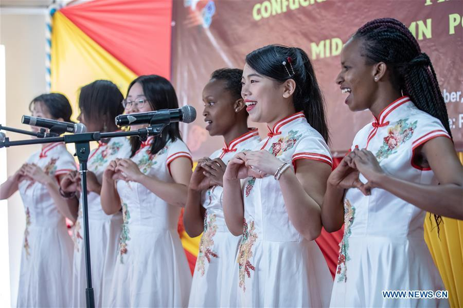 Chinese volunteers and students of the Confucius Institute of Kenyatta University sing a Chinese song at Kenyatta University in Nairobi, Kenya, on Sept. 21, 2018. The Confucius Institute of University of Nairobi and the Confucius Institute of Kenyatta University held celebrations respectively on Friday to mark the upcoming Mid-Autumn Festival, which falls on Sept. 24 this year. (Xinhua/Zhang Yu)