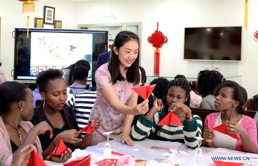 A Chinese volunteer teaches paper-cut at the Confucius Institute of the University of Nairobi, in Nairobi, Kenya, on Sept. 21, 2018. The Confucius Institute of University of Nairobi and the Confucius Institute of Kenyatta University held celebrations respectively on Friday to mark the upcoming Mid-Autumn Festival, which falls on Sept. 24 this year. (Xinhua/Wang Teng)