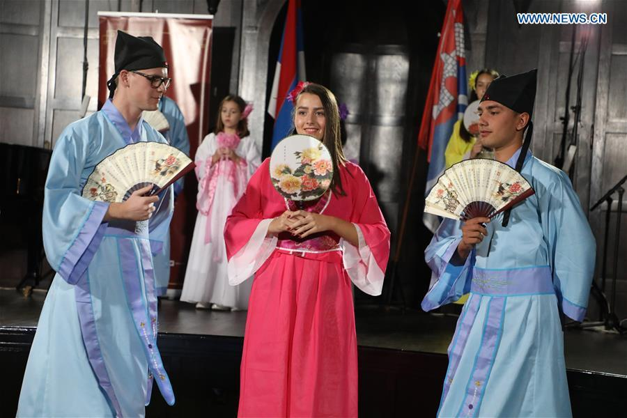 Students of the Confucius Institute of Banja Luka University dance in Chinese traditional costumes in Banja Luka, Bosnia and Herzegovina, on Sept. 22, 2018. The Confucius Institute of Banja Luka University organized a series of interactive workshops on the occasion of the Day of Confucius Institutes through a diverse program of activities in promoting Chinese culture here on Saturday. (Xinhua/Haris Memija)