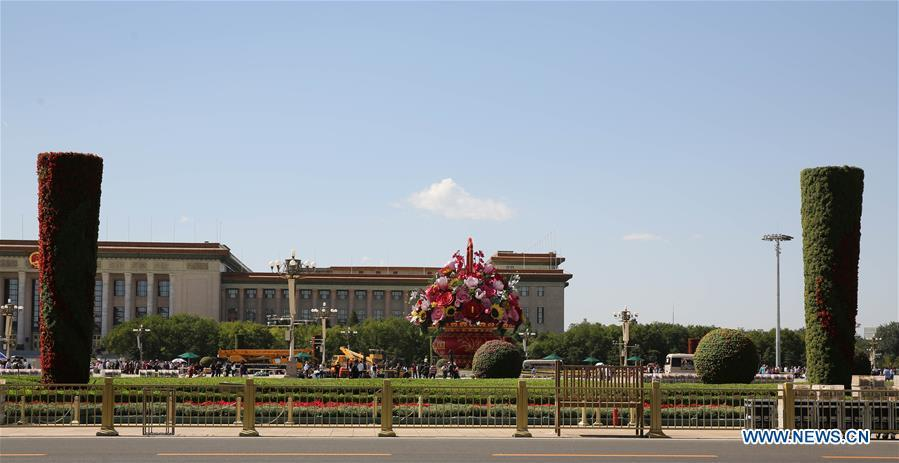 Workers set up decorating parterres on the Tian\'anmen Square in Beijing, capital of China, Sept. 21, 2018. Decorating parterres are set up in Beijing to greet the National Day, which falls on Oct. 1. (Xinhua/Liang Zhiqiang)