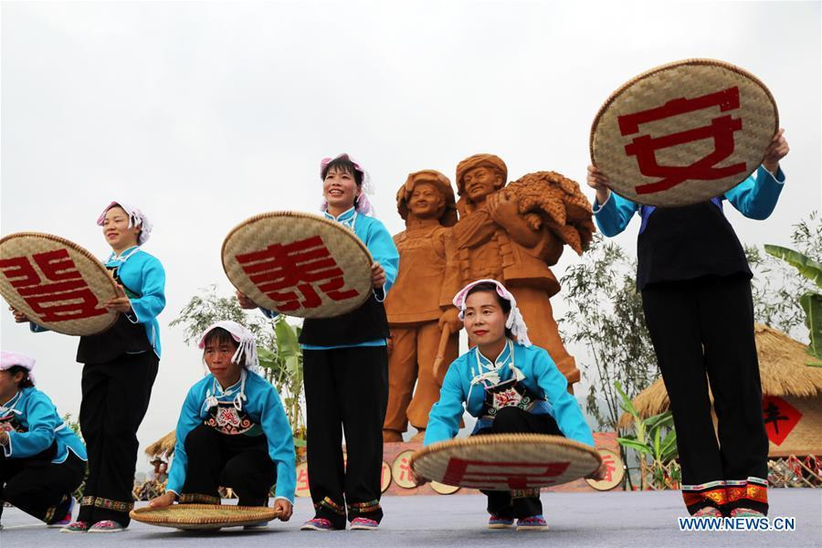Villagers dance in celebration of China\'s first Farmers\' Harvest Festival in Baping Village of Mangchang Township in Nandan County, Hechi, south China\'s Guangxi Zhuang Autonomous Region, Sept. 23, 2018. People across China hold various activities to celebrate the country\'s first Farmers\' Harvest Festival, which falls on Sept. 23 this year. (Xinhua/Fu Longqiang)