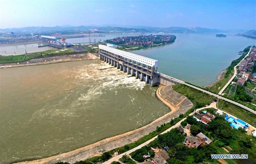 Aerial photo taken on January 2, 2017 shows the view of the Changzhou water control project on the Xijiang River, in Wuzhou, south China\'s Guangxi Zhuang Autonomous Region. Xijiang River is an important trade route in southwest China. (Xinhua/Zhou Hua)