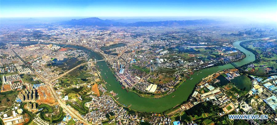 Aerial photo taken on March 9, 2018 shows the view of Guigang City along the Xijiang River, south China\'s Guangxi Zhuang Autonomous Region. Xijiang River is an important trade route in southwest China. (Xinhua/Zhou Hua)