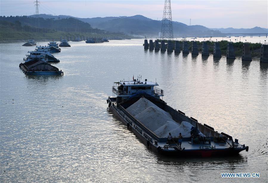 Cargo vessels pass the ship lock at the Changzhou reservoir, a water conservancy project on the Xijiang River, in Wuzhou, south China\'s Guangxi Zhuang Autonomous Region, Sept. 21, 2018. Xijiang River is an important trade route in southwest China. (Xinhua/Zhou Hua)