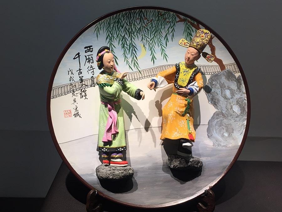 Colored sculptures are shown at the exhibition. (Photo/China Daily)
