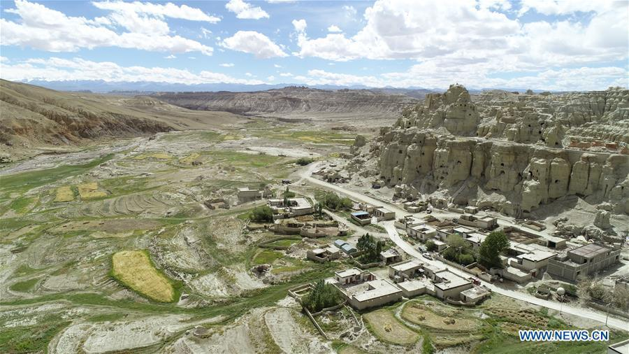 Aerial photo taken on Sept. 11, 2018 shows the ancient grottoes of Donggar on the hills in Ngari, southwest China\'s Tibet Autonomous Region. The Ngari area has an average altitude of over 4,000 meters above sea level. (Xinhua/Purbu Zhaxi)