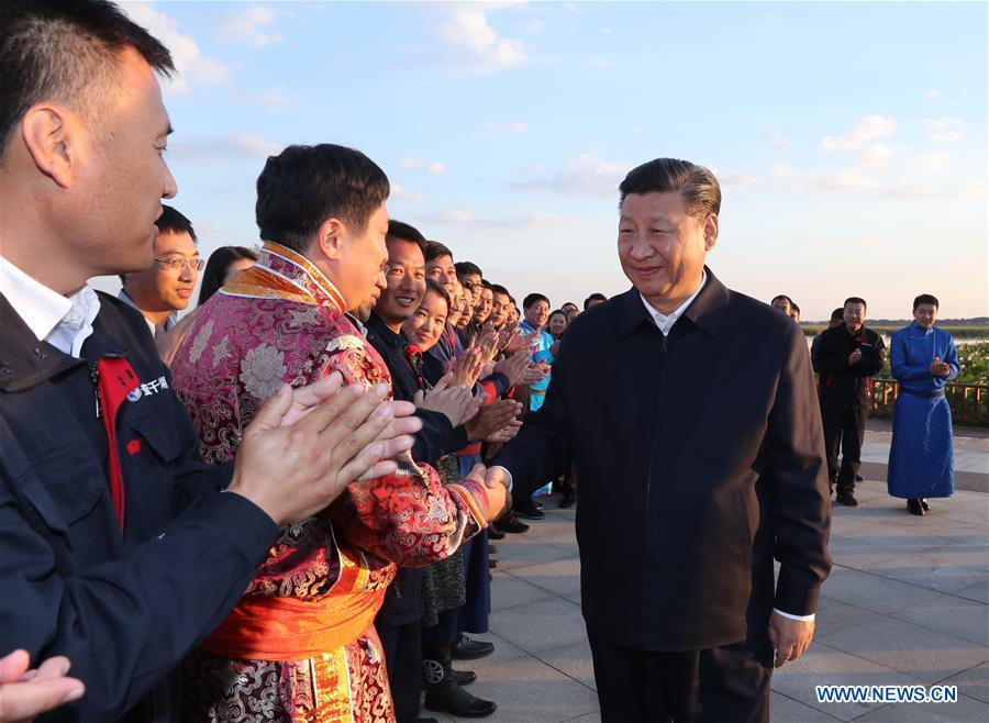 Chinese President Xi Jinping, also general secretary of the Communist Party of China (CPC) Central Committee and chairman of the Central Military Commission, meets with local residents by the Chagan Lake in Songyuan, northeast China\'s Jilin Province, Sept. 26, 2018. Xi inspected Songyuan on Wednesday. (Xinhua/Ju Peng)