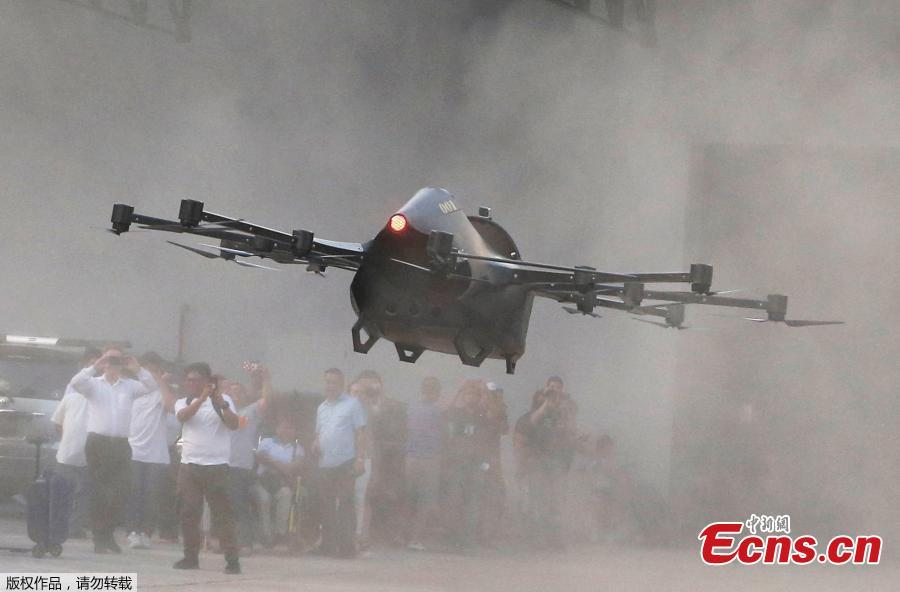 """Filipino inventor Kyxz Mendiola tests his flying car during its launch in the province of Batangas, Philippines, September 23, 2018. Former dancer and camera operator Kyxz Mendiola flew and hovered for a few minutes in a single-passenger contraption powered by the """"multicopter"""" technology commonly used in small unmanned drones. (Photo/Agencies)"""