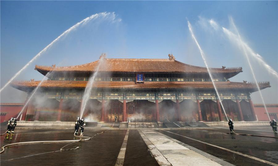 Drills are staged frequently at the Palace Museum in Beijing, where a team is stationed by the east gate to keep watch for fire in turn 24 hours a day. (Photo/CHINA DAILY)  Urgent situations  On Sept. 7, four days after the inferno in Rio, the State Administration of Cultural Heritage issued a notice urging museums nationwide to learn from the Brazilian blaze and improve awareness of protecting their collections.  The notice instructed museums to check their fire alarms, investigate whether their power lines are out of date, assign personnel to supervise fire prevention, and include this work in an overall evaluation system.  Devastating fires at Chinese museums are not common, the most recent major accident being a fire in 1994 at a museum in Jilin city, Northeast China\'s Jilin province. Two lives and thousands of cultural relics were lost.  However, a conference held by the State Administration of Cultural Heritage and the Ministry of Emergency Management on Sept 13 gave little room for optimism.  Liu Yuzhu, director of the administration, said: \