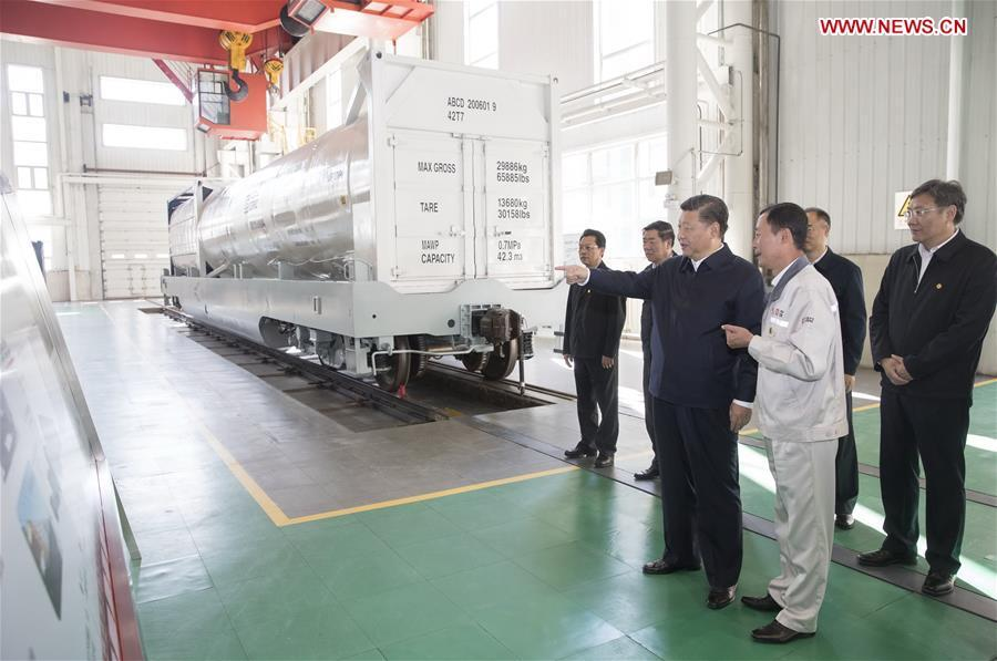Chinese President Xi Jinping, also general secretary of the Communist Party of China (CPC) Central Committee and chairman of the Central Military Commission, visits a research center of China Railway Rolling Stock Corporation (CRRC) Qiqihar Co. in Qiqihar, northeast China\'s Heilongjiang Province, Sept. 26, 2018. Xi inspected Qiqihar on Wednesday. (Xinhua/Wang Ye)