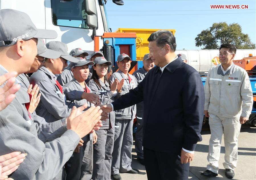 Chinese President Xi Jinping, also general secretary of the Communist Party of China (CPC) Central Committee and chairman of the Central Military Commission, shakes hands with workers during his visit to China Railway Rolling Stock Corporation (CRRC) Qiqihar Co. in Qiqihar, northeast China\'s Heilongjiang Province, Sept. 26, 2018. Xi inspected Qiqihar on Wednesday. (Xinhua/Ju Peng)