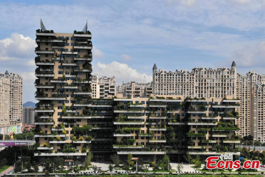 A drone photo shows a building covered with plants in Jurong City, East China's Jiangsu Province, Sept. 26, 2018. The building looks like a vertical forest. (Photo: China News Service/Yang Bo)