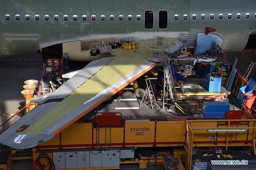 Staff members work at Airbus\' Tianjin final assembly line for the A320-family of jets in north China\'s Tianjin, Sept. 27, 2018. From the time it was established in 2008 until the end of this August, the Tianjin final assembly line assembled and delivered a total of 378 A320s. (Xinhua/Li Ran)