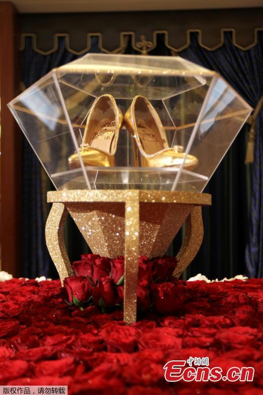 Touted as the world\'s most expensive footwear at $17 million, the Passion Diamond shoes is on display alongside Jada Dubai\'s newly launched collection of jewelled shoes at Burj Al Arab, Dubai, Sept. 26, 2018. Made in collaboration with Dubai\'s Passion Jewellers, the Passion Diamond pair are crafted from real gold, while a D-flawless 15-carat diamond adorns the toe of each stiletto. A total of 236 diamonds line the opening of the shoe where it meets the foot.(Photo/Agencies)