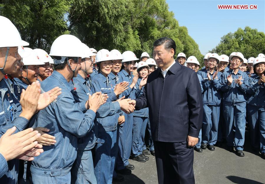 Chinese President Xi Jinping, also general secretary of the Communist Party of China (CPC) Central Committee and chairman of the Central Military Commission, shakes hands with workers during his visit to China National Petroleum Corporation (CNPC) Liaoyang Petrochemical Company in Liaoyang, northeast China\'s Liaoning Province, Sept. 27, 2018. Xi started an inspection tour in Liaoning on Thursday. (Xinhua/Ju Peng)
