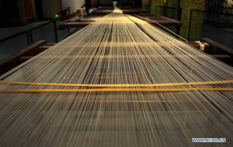 Photo taken on Sept. 26, 2018 shows silk thread exhibited at the Nanjing Yunjin Museum in Nanjing, capital of east China\'s Jiangsu Province. Yunjin, also called Yun brocade, is traditional Chinese silk brocade made in Nanjing of Jiangsu. Dated from the Eastern Jin Dynasty, it has formed its own characteristics through its development of 1,600 years. Yun brocade is famous for its exquisite craft, elegant patterns and smooth texture, and the making of the artwork requires close cooperation of two weavers, who can produce only five centimeters a day. In 2009, Yun brocade was inscribed on the Representative List of the Intangible Cultural Heritage of Humanity. (Xinhua/Sui Xiankai)