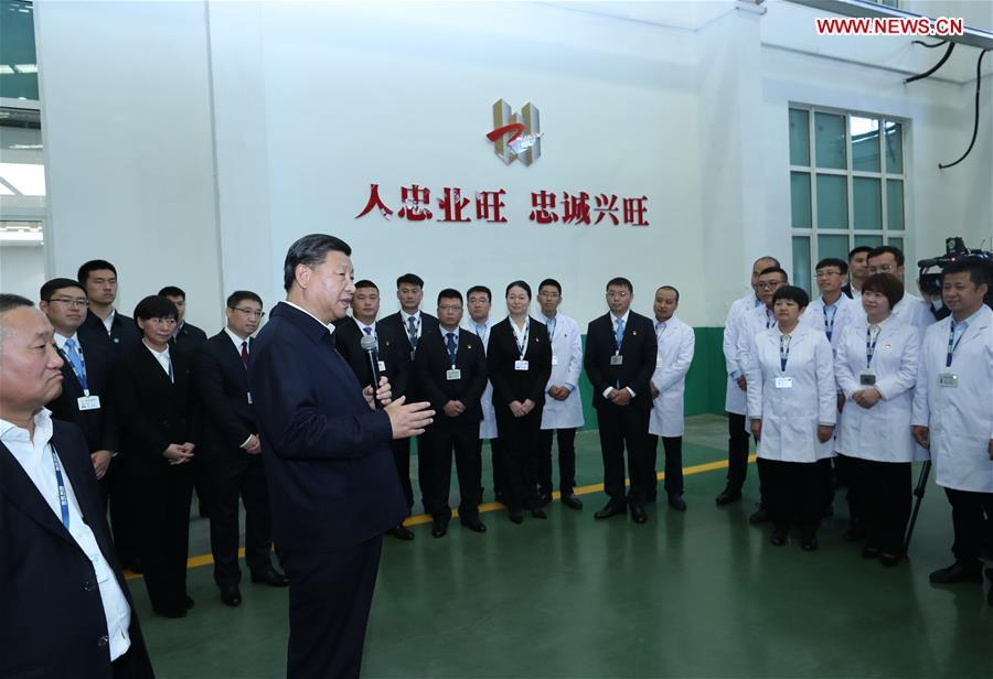 Chinese President Xi Jinping, also general secretary of the Communist Party of China (CPC) Central Committee and chairman of the Central Military Commission, speaks to workers during his visit to Liaoning-based China Zhongwang Holding in northeast China\'s Liaoning Province, Sept. 27, 2018. Xi started an inspection tour in Liaoning on Thursday. (Xinhua/Ju Peng)