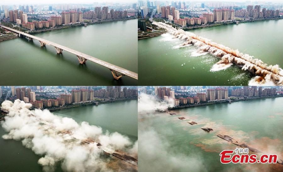 An old bridge is demolished in a controlled explosion in Ji'an City, East China's Jiangxi Province, Sept. 28, 2018. The bridge, 1,577 meters long and 19.5 meters wide, fell into disrepair after heavy traffic amid rapid economic growth. (Photo: China News Service/Hong Yi)