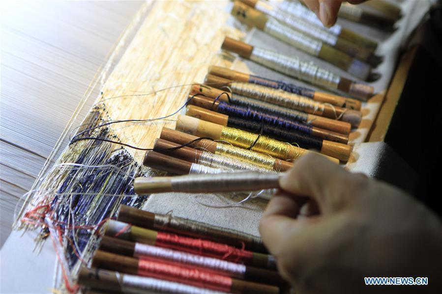 Photo taken on Sept.26, 2018 shows colorful silk threads used for weaving Yun brocade at the Nanjing Yunjin Museum in Nanjing, capital of east China\'s Jiangsu Province. Yunjin, also called Yun brocade, is traditional Chinese silk brocade made in Nanjing of Jiangsu. Dated from the Eastern Jin Dynasty, it has formed its own characteristics through its development of 1,600 years. Yun brocade is famous for its exquisite craft, elegant patterns and smooth texture, and the making of the artwork requires close cooperation of two weavers, who can produce only five centimeters a day. In 2009, Yun brocade was inscribed on the Representative List of the Intangible Cultural Heritage of Humanity. (Xinhua/Sui Xiankai)