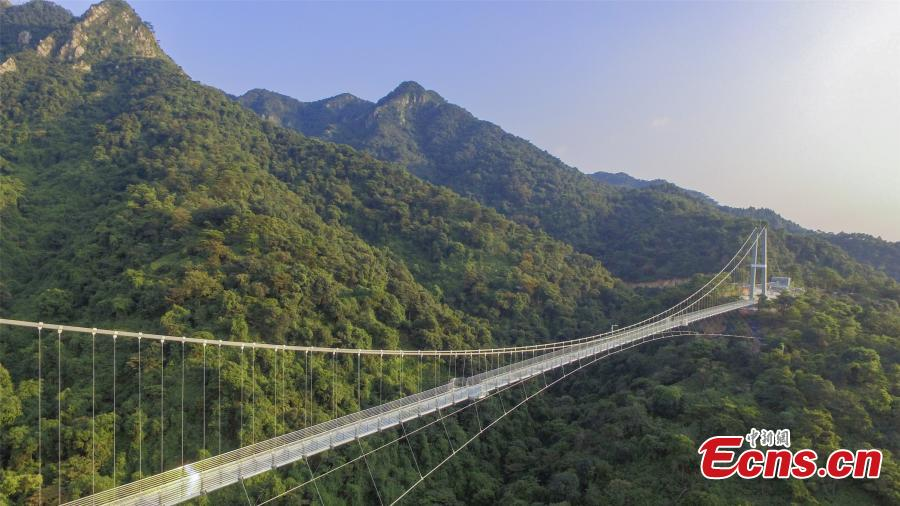 A drone photo shows a 379-meter-long glass bridge built in the Nandan Mountain area in Foshan City, South China's Guangdong Province, which opened on Sept. 28, 2018 after passing safety test. The glass bridge, suspended 202 meters above the ground, makes use of innovative technology to create impressive sound and visual effects. (Photo: China News Service/Zeng Linghua)