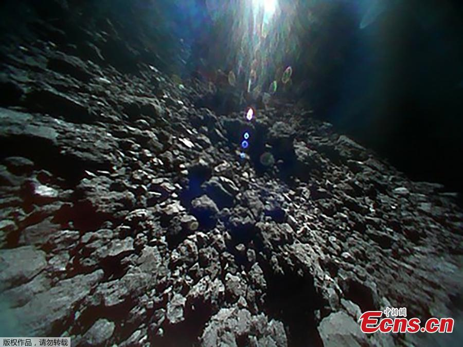 A handout photo made available by Japan Aerospace Exploration Agency (JAXA) shows an image of the surface of asteroid Ryugu, in space, Sept. 23, 2018, captured immediately before hop of Rover-1B. The MINERVA-II1 rovers, Rover-1A and Rover-1B, were deployed on Sept. 21 to explore the surface of asteroid Ryugu. (Photo/Agencies)