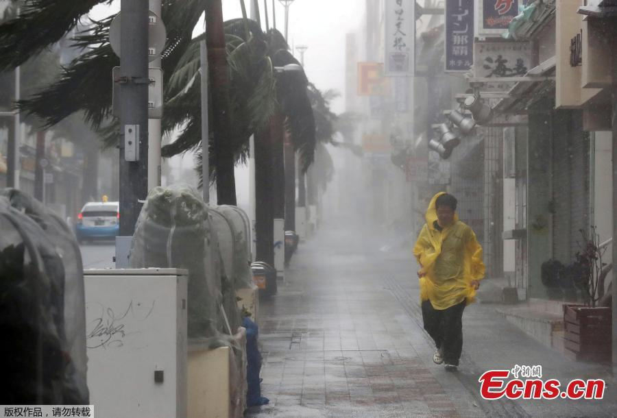 A person walks in the street during strong rain and wind in Naha, Okinawa Prefecture, Sept. 29, 2018, as typhoon Trami approaches Japan\'s southernmost prefecture. (Photo/Agencies)