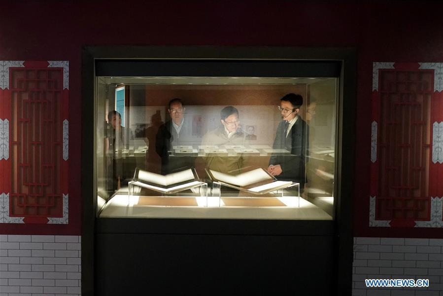 Visitors view exhibits during an exhibition on Yongle Encyclopaedia at National Library of China in Beijing, capital of China, Sept. 28, 2018. Yongle Encyclopaedia is China\'s first encyclopaedia compiled in the Ming Dynasty (1368-1644). The exhibition kicked off here on Friday. (Xinhua/Yin Gang)