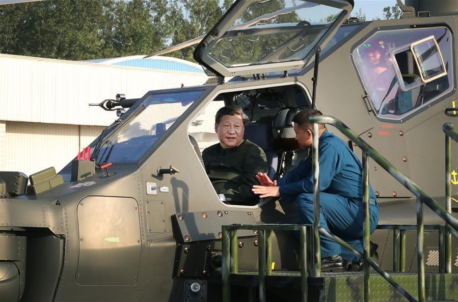 Chinese President Xi Jinping, also general secretary of the Communist Party of China (CPC) Central Committee and chairman of the Central Military Commission, boards a Z-10 helicopter and manipulates the airborne weapon and aiming system during his inspection, Sept. 27, 2018. Xi inspected the 79th Group Army of the People\'s Liberation Army and met with senior officers of troops stationed in northeast China\'s Liaoning Province from Sept. 27 to 28. (Xinhua/Li Gang)