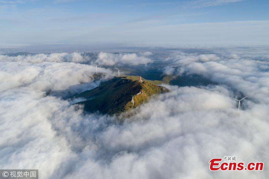 Photo taken on Sept. 29, 2018 shows the amazing natural landscape on Mifeng Mountain, or 'bees mountain,' north shore of the Xingkai Lake on the border between China and Russia, in Jixi City, Northeast China's Heilongjiang Province. It's the best time to visit the mountain, a national geopark with splendid autumn colors. (Photo/VCG)