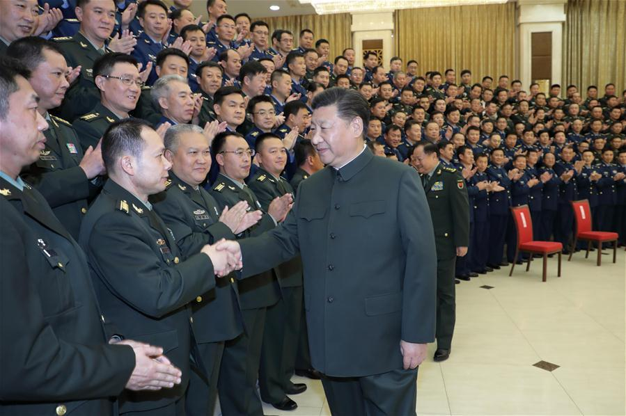 Chinese President Xi Jinping, also general secretary of the Communist Party of China (CPC) Central Committee and chairman of the Central Military Commission, meets with senior officers of troops stationed in northeast China\'s Liaoning Province, in Liaoning\'s capital city Shenyang, Sept. 28, 2018. Xi inspected the 79th Group Army of the People\'s Liberation Army and met with senior officers of troops stationed in Liaoning from Sept. 27 to 28. (Xinhua/Li Gang)