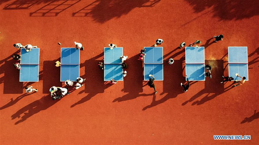 Aerial photo taken on Sept. 26, 2018 shows students playing table tennis at Xiaogang Primary School in Xiaogang Village of Fengyang County, east China\'s Anhui Province. Xiaogang, known as cradle of China\'s rural reform, witnessed great change in the past 40 years. (Xinhua/Zhang Duan)